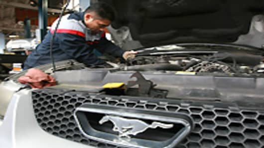 Mechanic Harrison Garcia works on a Ford Mustang at Brake and Wheel Service Center in San Francisco, California.