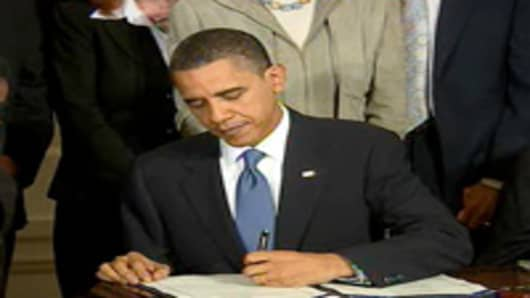 President Obama signs the health care reform bill into law at the White House