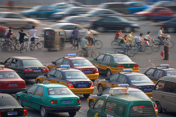 Per Capita Income: $6,500 National Income Tax Range: 5%-45% Statutory Retirement Age (Men/Women): 60/50* Weekly Working Hours: 44 Vacation Days: 21 Pictured: Traffic on Changan Avenue during rush hour, Beijing, China.