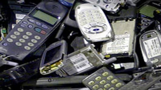 A pile of old cellular phones.