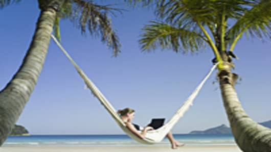 Woman in hammock using laptop