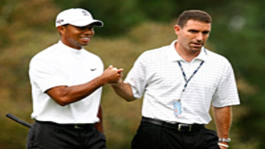 Tiger Woods walks alongside his manager Mark Steinberg of IMG during a practice round prior to the start of THE TOUR Championship at East Lake Golf Club in Atlanta, Georgia.