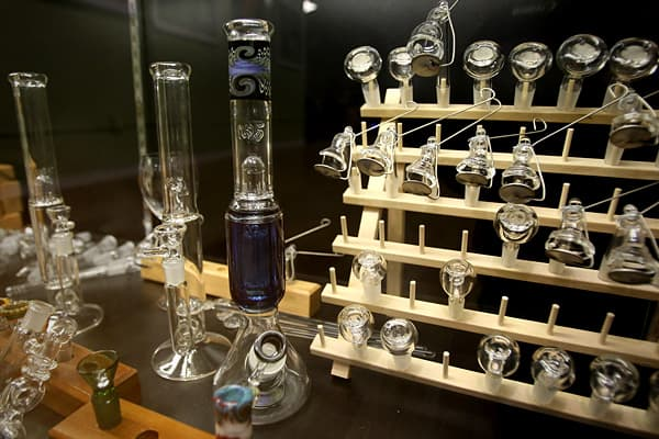 "Similar to hookahs, bongs are an air-tight smoking device that bubbles smoke through water, reducing irritation to the airways by absorbing heavier particles that would be otherwise inhaled. Bongs are generally blown from glass, but they can also be ceramic, stone or constructed from household products. They can range in price - from $10 to $400 - and size - from several inches to several feet. Some retailers avoid the use of the term ""bong"" as the word itself suggests the intent to use marijuan"