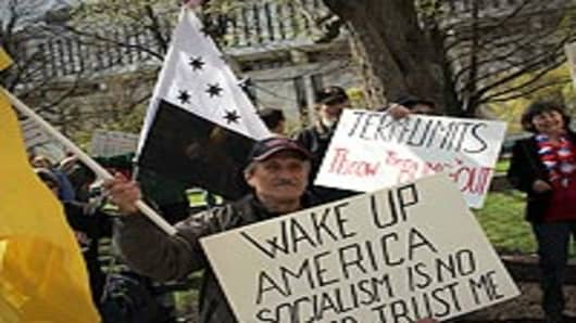 A participant at a Tea Party Express rally displays a sign critical of the Obama administration on April 13, 2010 in Albany, New York. The Tea Party Express will head to Boston on Wednesday where the headline speaker at an afternoon rally will be Sarah Palin.