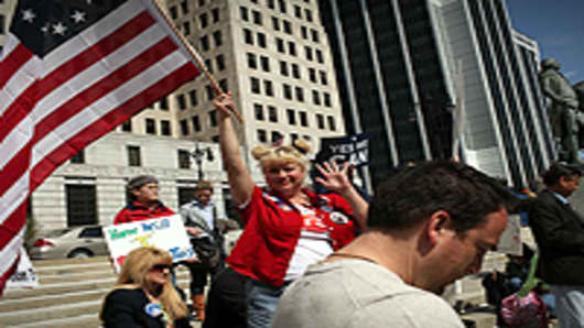 A participant waves an American flag at a Tea Party Express rally in Albany, New York.