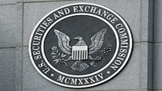 The U.S. Securities and Exchange Commission seal hangs on the facade of its building in Washington, DC.