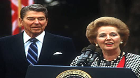 President Ronald Reagan watches as British Prime Minister Margaret Thatcher speaks November 16, 1988 in Washington, DC.