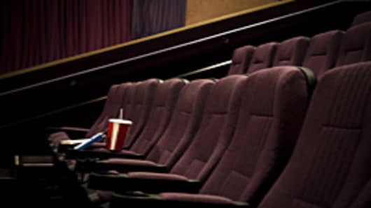 Lone drink and candy in empty theater