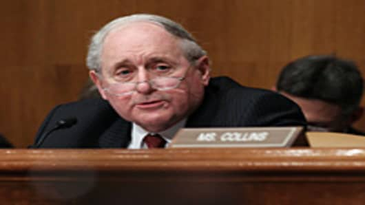 Chairman Carl Levin questions former and current Goldman Sachs employees during a Senate Homeland Security and Governmental Affairs Investigations Subcommittee hearing on Capitol Hill.