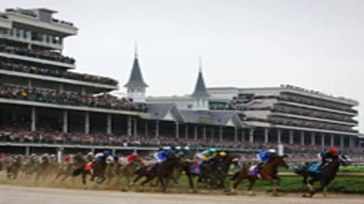 The field rounds turn one during the 135th running of the Kentucky Derby on May 2, 2009 at Churchill Downs in Louisville, Kentucky.