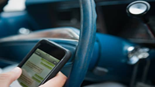 Person text messaging while driving