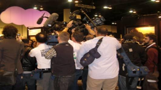 Camera operators chase Warren Buffett at Berkshire Hathaway annual shareholders meeting