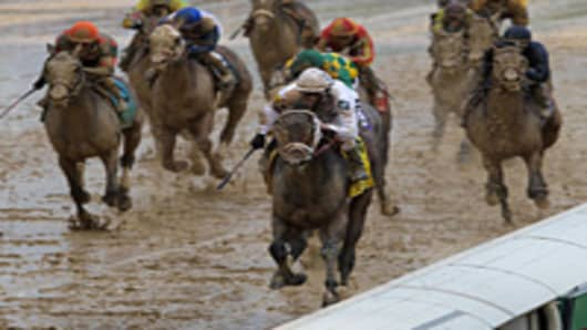 Calvin Borel atop Super Saver races to the finish line to win the 136th running of the Kentucky Derby on May 1, 2010 in Louisville, Kentucky.