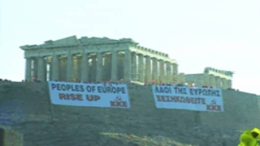 Greek communist protesters draped banners on the Acropolis. May 4, 2010.