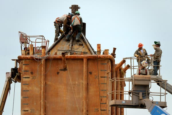 Welders at work on the Pollution Control Dome being built by steelworkers at the Martin Terminal worksite in Port Fourchon, as BP rushes to cap the source of the oil slick.