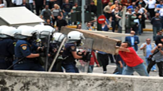 Greek riot policemen clash with protestors in the center of Athens on May 5, 2010.