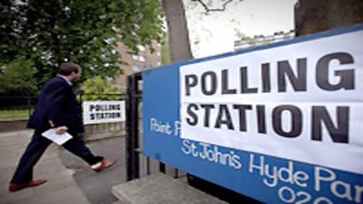 A man arrives at a polling station at St Johns Parish Church, London.