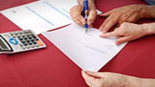 signing_loans_140.jpg