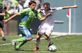 Leonardo Gonzalez of the Seattle Sounders FC battles Chris Klein of the Los Angeles Galaxy on May 8, 2010 at Qwest Field in Seattle, Washington.The Galaxy defeated the Sounders 4-0.