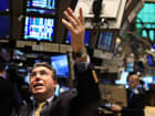 Traders work on the floor of the New York Stock Exchange during morning trading.