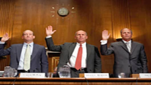 BP America Chairman and President Lamar McKay, Transocean President and CEO Steven Newman and Tim Probert, president of global business lines, and chief health, safety and environmental officer at Halliburton, are sworn in before testifying to the Senate Environment and Public Works Committee about the Deepwater Horizon explosion and oil spill in the Gulf of Mexico.