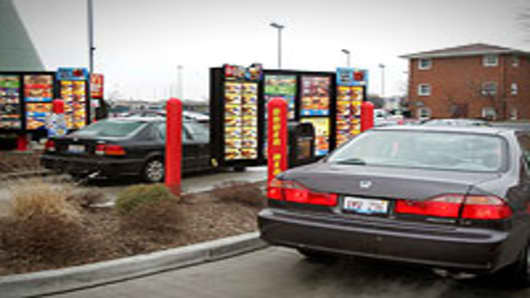 Vehicles in two separate drive-up lanes place orders at a McDonald's drive-thru location in Rosemont, Illinois.