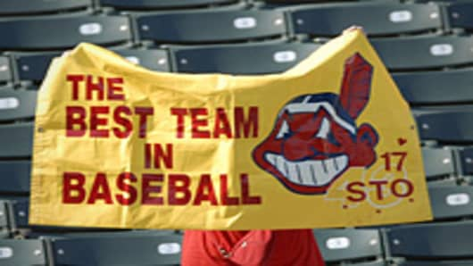 Cleveland Indians fan holding up a banner prior to a game