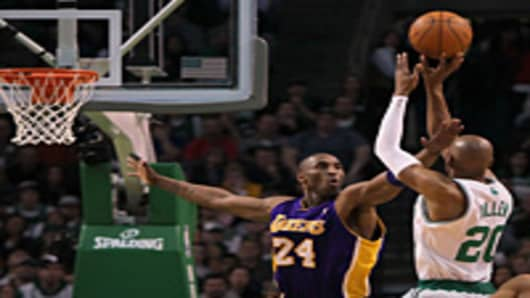Ray Allen of the Boston Celtics shoots over Kobe Bryant of the Los Angeles Lakers at the TD Garden.
