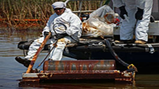 Contract workers from BP use skimmers to clean oil from a marsh near Pass a Loutre on June 1, 2010 near Venice, Louisiana. Earlier in the day, U.S. President Barack Obama called the Deepwater Horizon accident the 'greatest environmental disaster of its kind in our history.'