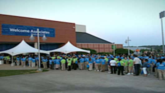 Employees line up for a Walmart meeting.