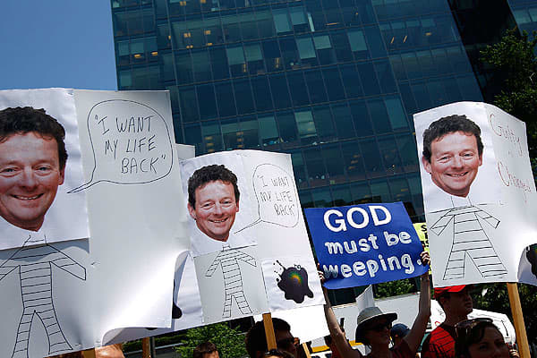 Demonstrators hold up hand-made signs with the image of BP CEO Tony Hayward while protesting the company's handling of the Deepwater Horizon oil spill across the street from the oil giant's Washington offices.