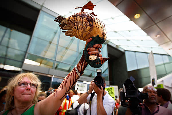 Consumer advocate Barbara Holzer holds up a model duck coated in chocolate syrup made to look like oil while demonstrating with about 50 others in front of the Washington offices of oil giant BP to protest the company's handling of the Deepwater Horizon oil spill.Representatives of Greenpeace, Public Citizen, Energy Action Coalition, Chesapeake Climate Action Network and others tried to carry out a 'mock citizen's arrest' of BP CEO Tony Hayward but were turned away at the building's doors.