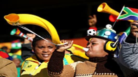 A fan blows a vuvuzela at the 2010 FIFA World Cup.