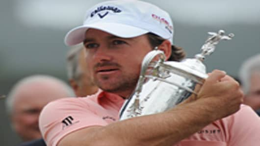 Northern Ireland's Graeme McDowell hugs the US Open Trophy after winning the 110th U.S. Open in Pebble Beach, California.