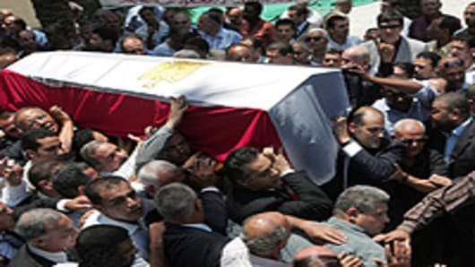 Mourners attend the funeral of Egyptian billionaire Ashraf Marwan in Cairo 01 July 2007. The controversial celebrity allegedly acted as a secret agent for the Israeli secret service during the 1973 Arab-Israeli war, reportedly with the code name 'Babel'. Ashraf Marwan was found dead in London on 27 June 2007 and was a son-in-law of former Egyptian president Gamal Abdel Nasser.