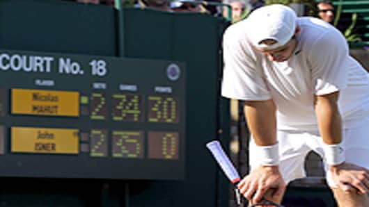 John Isner of USA reacts during his first round match against Nicolas Mahut of France on Day Three of the Wimbledon Lawn Tennis Championships at the All England Lawn Tennis and Croquet Club on June 23, 2010 in London, England. The match has become the longest in Grand Slam history.