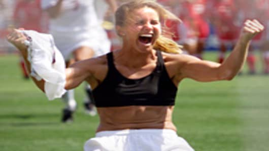 Brandi Chastain shouts after falling on her knees after she scored the last goal in a shoot-out in the finals of the 1999 Women's World Cup against China.