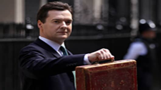 Chancellor of the Exchequer George Osborne holds Disraeli's original budget box as he leaves 11 Downing Street for Parliament.