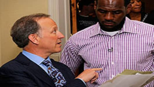 Jim Gray (L) of ESPN speaks with LeBron James at attends the LeBron James Pre Decision Meet and Greet on July 8, 2010 in Greenwich, Connecticut.