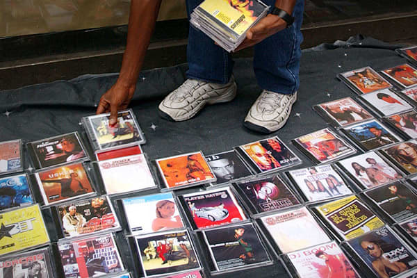 2009 Domestic Seizure Value: $11.09 millionPercent of Total Seizures: 4%A dealer of counterfeit pop and rap music CDs sells his merchandise on a street in New York City.