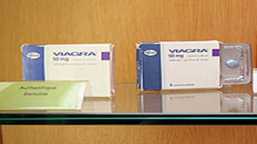 Genuine and counterfeit Viagra displayed at The Counterfeit Museum in Paris, France.