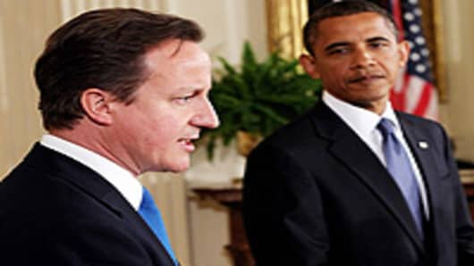British Prime Minister David Cameron (L) and U.S. President Barack Obama hold a joint news conference in the East Room of the White House July 20, 2010 in Washington, DC.