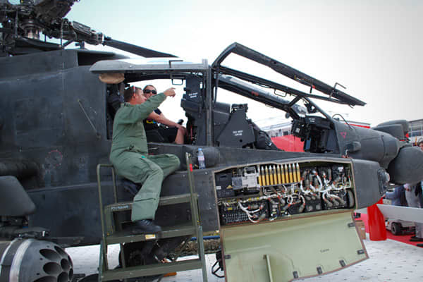 The UK Army Air Corp demonstrated the capabilities and let visitors take a cockpit tour of its Apache attack helicopter. The helicopters were first operational for use in the UK in 2005. A pilot can sit in the higher back seat of the cockpit, with a gunner or co-pilot in front, using the latest helmet-mounted heads up displays to find targets.