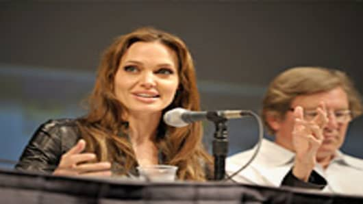 Actress Angelina Jolie and producer Lorenzo di Bonaventura speak onstage at the 'Salt' panel during Comic-Con 2010 at San Diego Convention Center.