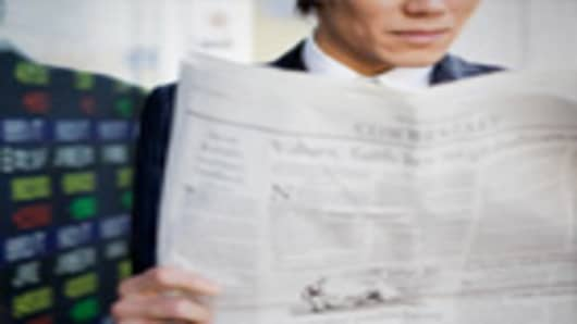 businessman_reading_paper_140.jpg