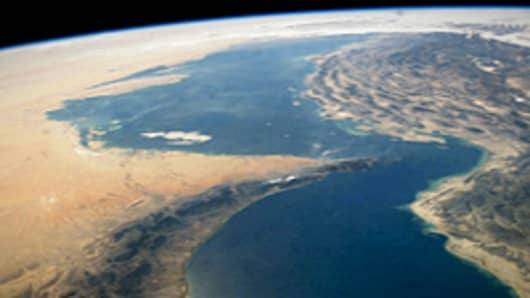 This satellite image shows the Strait of Hormuz, between the Persian Gulf and the Gulf of Oman. The Strait of Hormuz runs between Iran and United Arab Emirates.