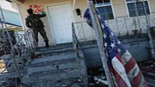 Marine from Camp Lejeune, N.C., marks a home to indicate he found no occupants as houses in the lower Ninth Ward are checked for bodies or people who are still stranded more than two weeks after Hurricane Katrina hit.