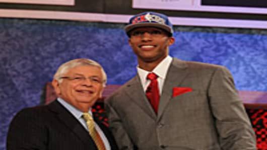 Evan Turner of Ohio State stands with NBA Commisioner David Stern after being drafted by the Philadelphia 76ers second overall at Madison Square Garden on June 24, 2010 in New York City.