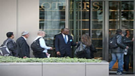 Lehman Brothers' employees arrive at work on September 19, 2008 in London, England. For many employees at the American investment bank, today is their final payday following Lehman Brothers going into administration earlier this week.