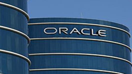 The Oracle logo is displayed on the company's world headquarters in Redwood Shores, California.
